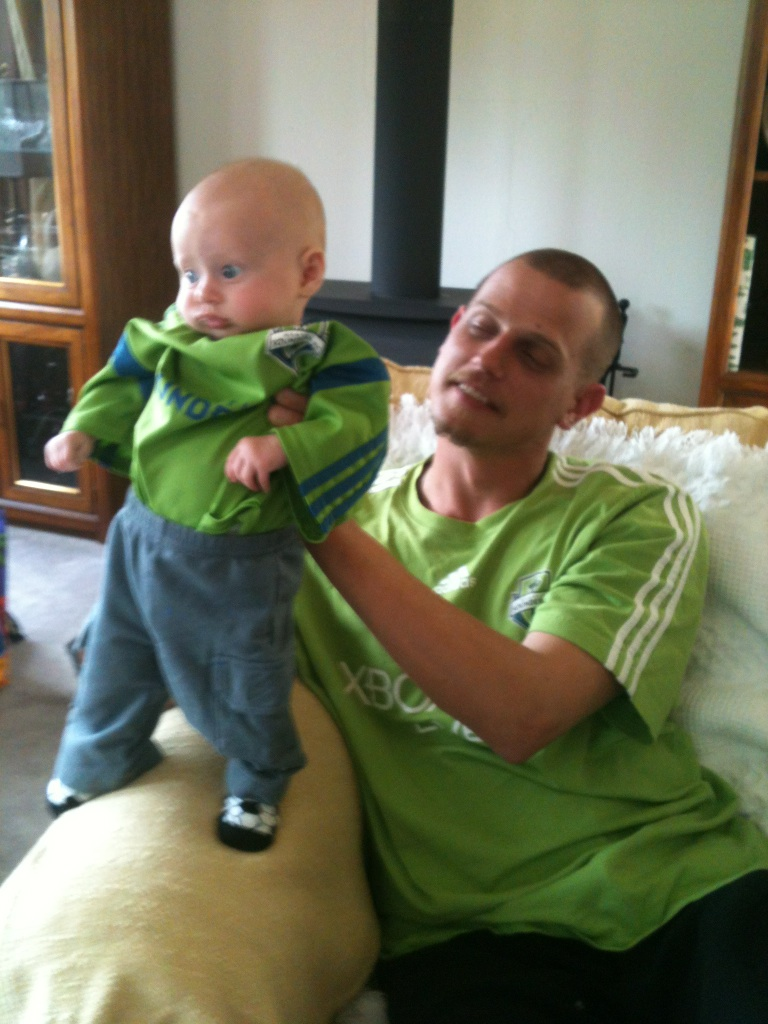 My nephew and his proud papa, decked out in Seattle Sounders wear.